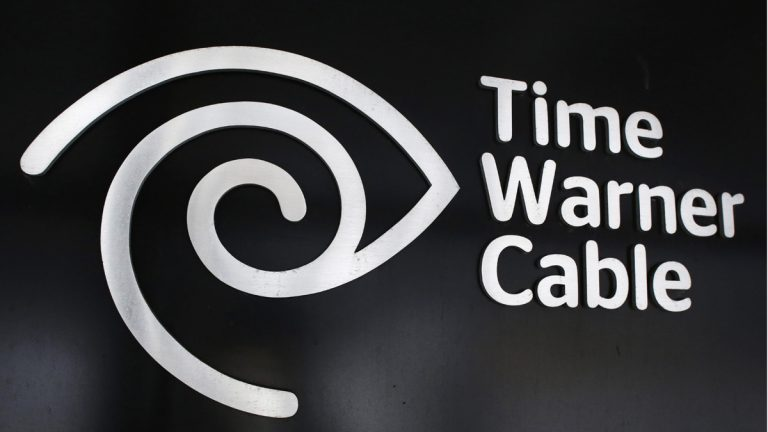 The Time Warner Cable corporate logo is displayed at a company store, Tuesday, May 26, 2015 in New York. Charter Communications is buying Time Warner Cable for $55.33 billion. And executives say they're confident regulators will allow the creation of another U.S. TV and Internet giant. (AP Photo/Mark Lennihan)