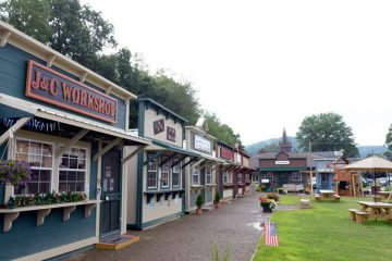 Tionesta Market Village consists of eleven outdoor sheds retrofitted to look like 18th-century storefronts.  Vendors include artists and local food producers.  (Kelly Tunney/for WPSU)