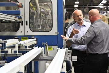 Pa. Gubernatorial Candidate Tom Wolf tours the Northeast Building Products factory in Northeast Philadelphia. (Kimberly Paynter/WHYY)