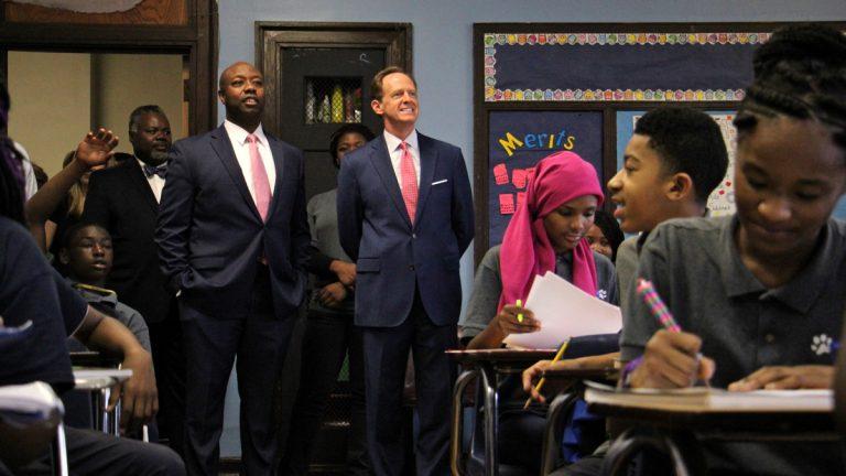 U.S. Sen. Pat Toomey (center) visits Belmont Charter School in West Philadelphia. (Emma Lee/WHYY)