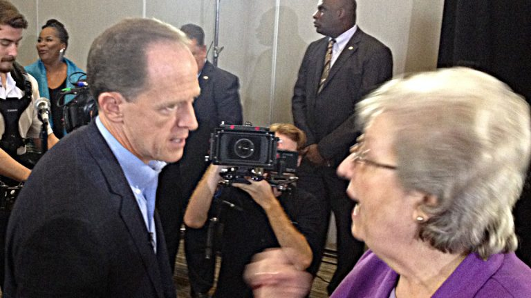 U.S.Sen. Pat Toomey chats with Republican state commiteewoman Kathy Kelly at his re-election announcement in King of Prussia. (Newsworks photo/Dave Davies)