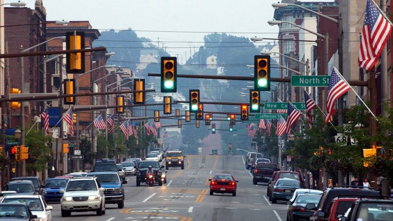 Traffic moves along the main street as signals change in Butler, Pa.  (AP File Photo/Keith Srakocic)