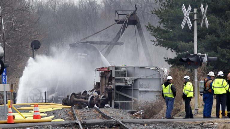 Crews spray water on derailed freight train tank cars in Paulsboro