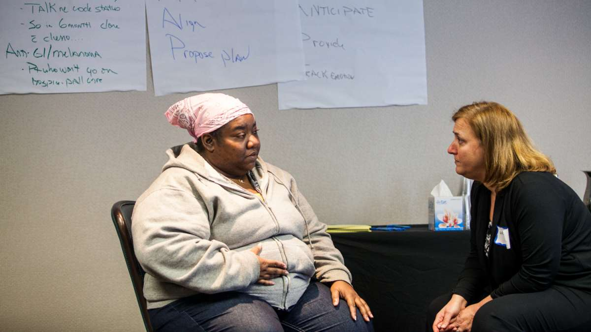 Actress Felicia Myers (left) portrayed a terminal cancer patient during the workshop. (Brad Larrison/for NewsWorks)