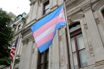 A transgender flag at City Hall in Philadelphia welcomed the recent Trans Health Conference. (Emma Lee/WHYY)