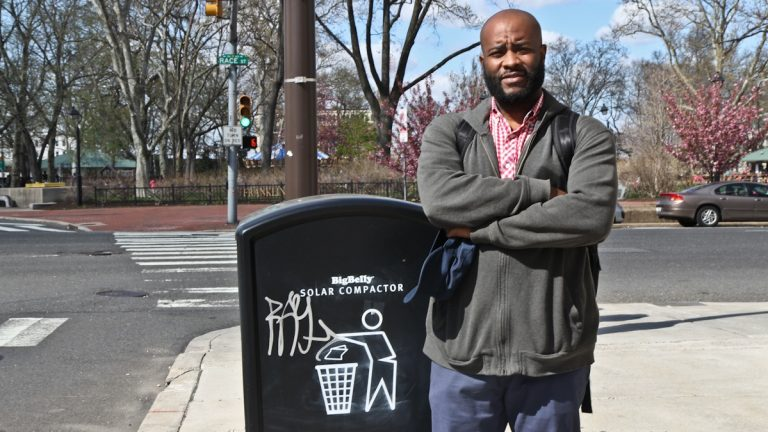 Kensington resident Dayo Adeyemi says he despises the solar compacting trash cans on the streets in Philadelphia. (Kimberly Paynter/WHYY)