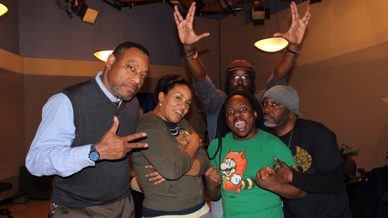 Dr. Derrick Pitts, left, henceforth known to Tribble Nation as UniversalTribble, stands with Storm Tribble (Kennedy Allen), Super Tribble (Randy Green), Spider-Tribble (Jason Richardson), and BatTribble (Len Webb) in WHYY's Studio 2. (Jeanette Woods/WHYY)