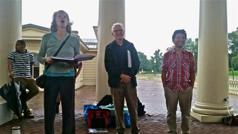 Mendelssohn Club Musical Director Alan Harler (center) attends rehearsal for his final production, TURBINE, at the Philadelphia Waterworks. He is joined by choreographer Leah Stein and composer Byron Au Yong. (Peter Crimmins/WHYY)