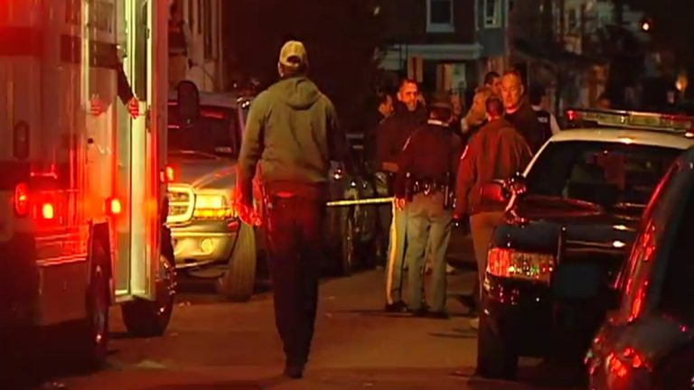 Police gather in Wilmington last November after a State Trooper was shot. (WHYY/File)