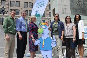 Delaware officials and activists stand next to Tropo, a new mascot for earth-friendly actions. (Matt Grady/NewsWorks)