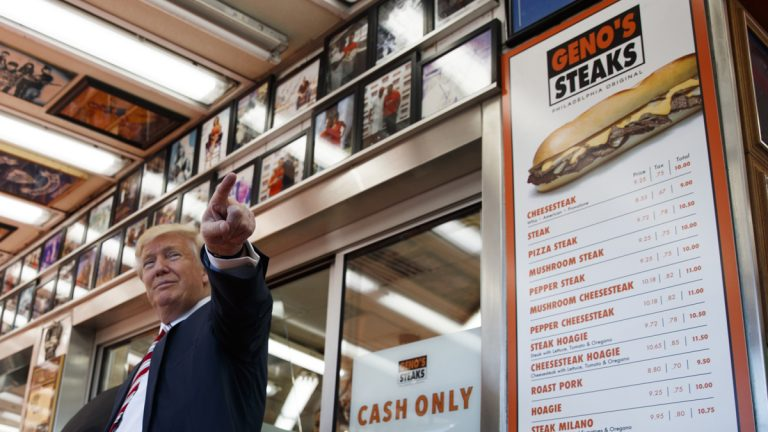Republican presidential candidate Donald Trump talks with customers during a visit to Geno's Steaks