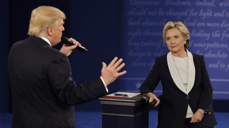 Democratic presidential nominee Hillary Clinton listens to Republican presidential nominee Donald Trump during the second presidential debate at Washington University in St. Louis