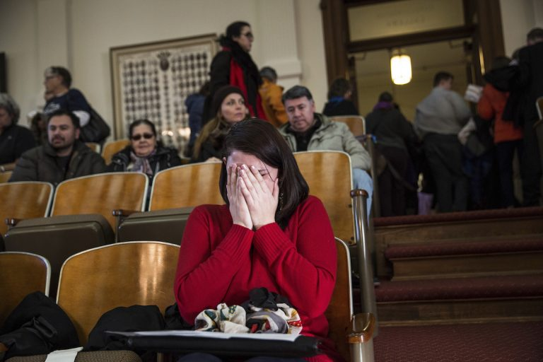A woman cries in the gallery of the House of Representatives after the Electoral College voted at the state Capitol in Austin