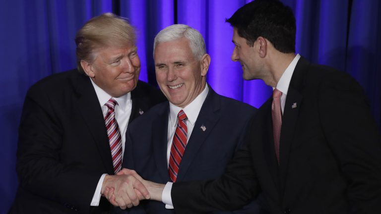 President Donald Trump with Vice President Mike Pence shakes hands with House Speaker Paul Ryan at the Republican congressional retreat in Philadelphia