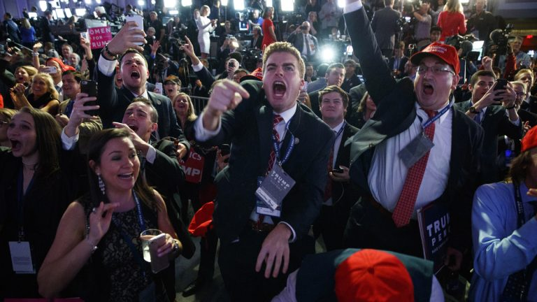 Supporters of Republican presidential candidate Donald Trump cheer as they watch election returns during an election night rally