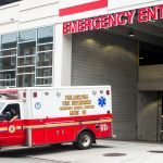 An ambulance pulls out of the emergency entrance at Temple University Hospital.