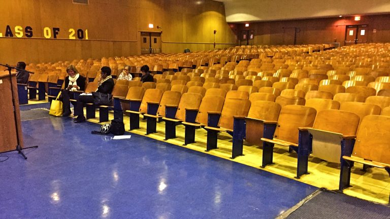 A handful of community members take seats in the Benjamin Franklin High School auditorium to learn about turnaround plans for the school. (Avi Wolfman-Arent/WHYY)