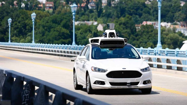 A self-driving Ford Fusion hybrid car is test driven