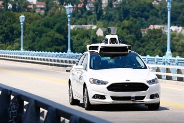 Uber employees test the self-driving Ford Fusion hybrid cars in Pittsburgh. (AP Photo/Jared Wickerham)