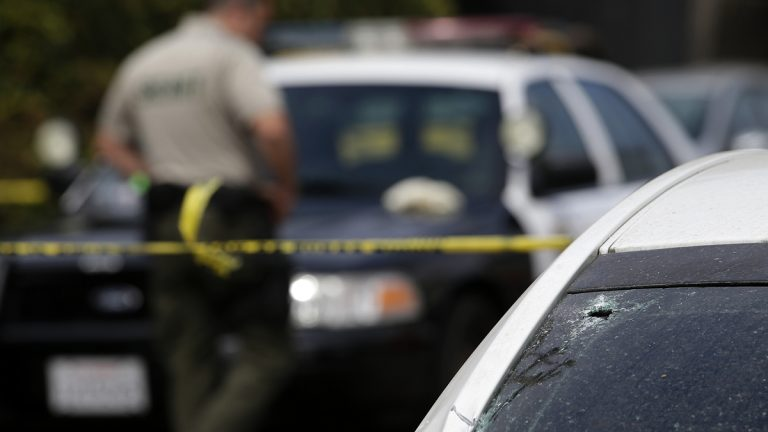 A windshield shattered by a bullet is shown at the scene of a shooting on Saturday, May 24, 2014, in Isla Vista, Calif. A drive-by shooter went on a rampage near a Santa Barbara university campus that left seven people dead, including the attacker, and others wounded, authorities said Saturday. (AP Photo/Jae C. Hong)