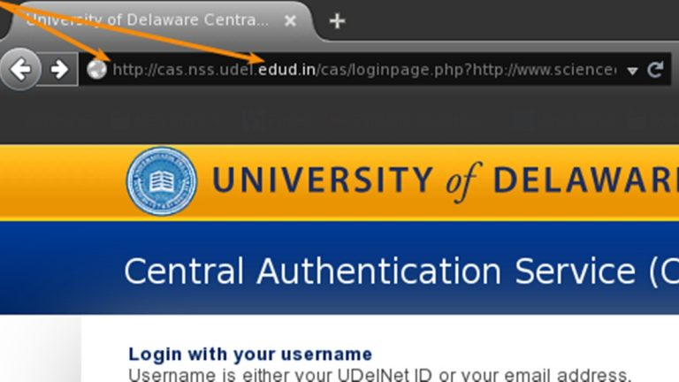The two arrows point to telltale signs this page is scammed copy of a UD login screen. (photo courtesy UDel.edu)