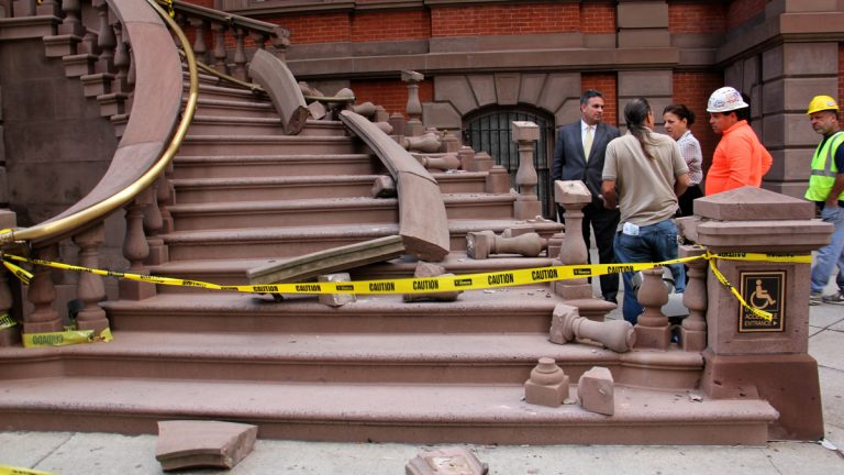 Workmen evaluate damage to the Union League staircase. (Emma Lee/WHYY)