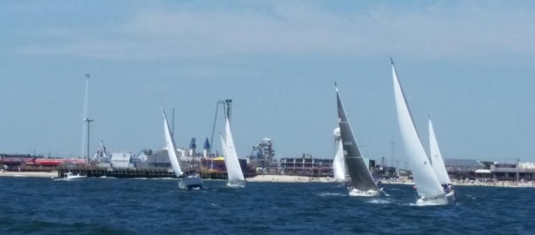 Sailboats racing in the third annual JetStar Regatta rounding the mark located near the final resting spot of the JetStar roller coaster off Seaside Heights and heading back up the beach to the finish at the Manasquan Inlet. (Image courtesy of Mark Connell)
