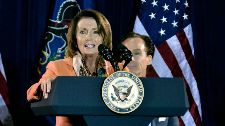U.S. House Minority Leader Nancy Pelosi speaks to a crowd at the Sheet Metal Workers Union Hall in Philadelphia Monday night. She and Vice President Joe Biden are urging city Democrats to give Hillary Clinton a landslide victory. ( (Bastiaan Slabbers/for NewsWorks)