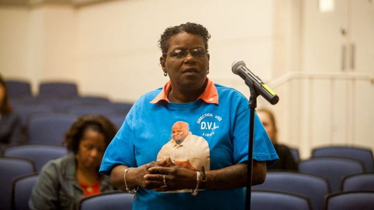 Delphine Matthews speaks at a listening session between the DOJ and residents of Chester. On her shirt is a picture of her son