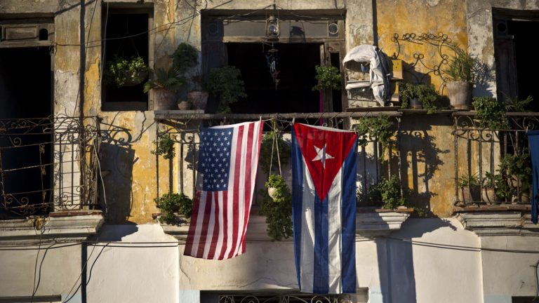 A U.S. and Cuban flag hang from the same balcony in Old Havana, Cuba, Friday, Dec. 19, 2014. After the surprise announcement on Wednesday of the restoration of diplomatic ties between Cuba and the U.S., many Cubans expressed hope that it will mean greater access to jobs and the comforts taken for granted elsewhere, and lift their struggling economy. However others feared a cultural onslaught, or that crime and drugs, both rare in Cuba, will become common along with visitors from the United States. (AP Photo/Ramon Espinosa)