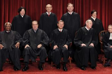 Chief Justice John Roberts is shown (front row, center) with the Associate Justices (back row) Sonia Sotomayor, Stephen Breyer, Samuel Alito Jr., (front row) Clarence Thomas, Antonin Scalia, Anthony Kennedy and Ruth Bader Ginsburg. (AP Photo/Pablo Martinez Monsivais)