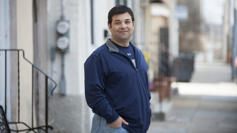 Steve Passio stands on Ridge Avenue in Roxborough. (Tracie Van Auken/for NewsWorks)