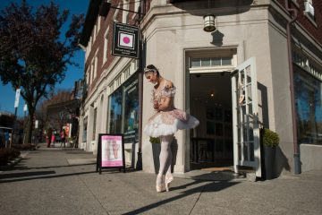 Sugarplum fairy Sara Schaeffer, a student at the School of Pennsylvania Ballet, awaits scavenger hunters participating in Chestnut Hill's The Nutcracker scavenger hunt along Germantown Avenue Saturday afternoon.