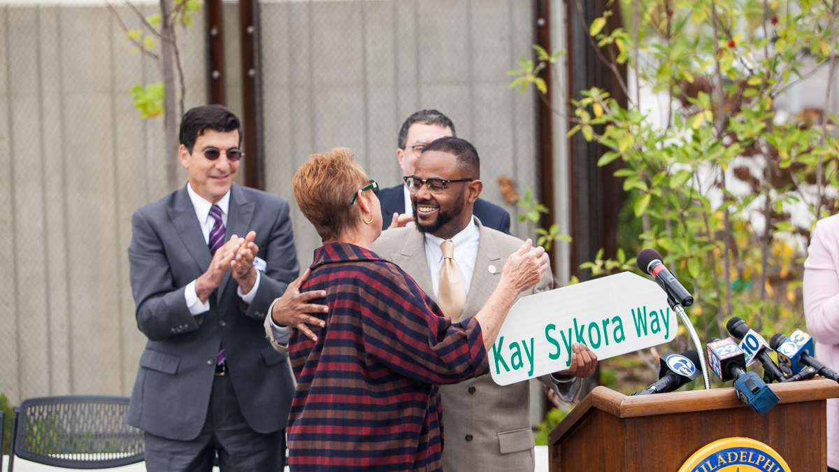 City Councilman Curtis Jones Jr. presented Kay Sykora of the Manayunk Development Corporation with a commemorative street sign honoring her efforts in the transformation of Venice Island. (Brad Larrison/for NewsWorks)