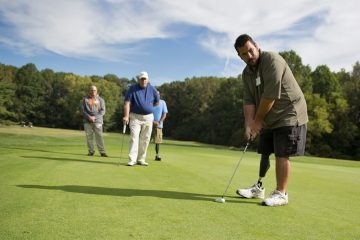 Tim Piper said that the golf clinic is more about therapy for him and being around other veterans than improving his golf game.  (Lindsay Lazarski/WHYY)