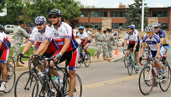 In this 2010 photo, participants 'Ride 2 Recovery' in the Rocky Mountain Challenge while active servicemen and women cheer along the riders. (Image courtesy of Ride2Recovery)
