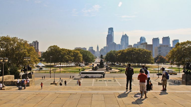 The view of the Benjamin Franklin Parkway from the top of the Philadelphia Museum of Art.  (Kimberly Paynter/WHYY)