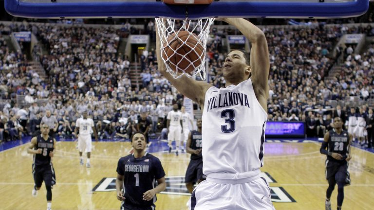 Villanova's Josh Hart dunks the ball during the first half of an NCAA college basketball game against Georgetown