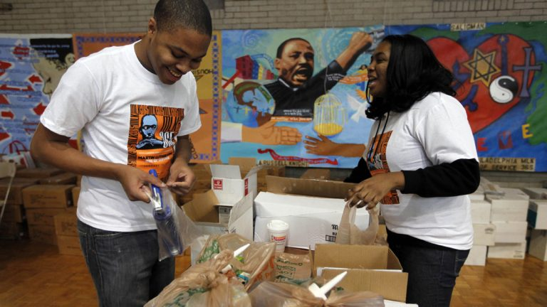 Volunteers Malcolm Kenyatta and Kylie Patterson assemble home weatherization kits during the Greater Philadelphia Martin Luther King Day of Service, at Girard College. (AP File Photo/Matt Rourke)
