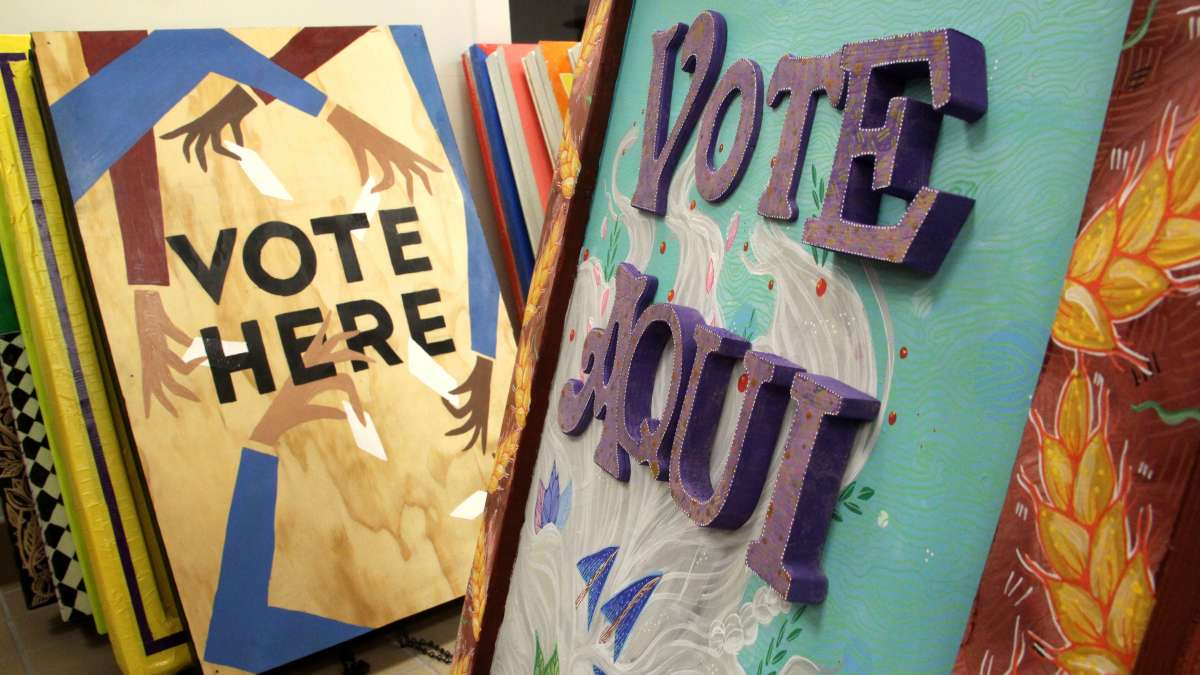 Local artists created signs to encourage voter participation. (Emma Lee/WHYY)