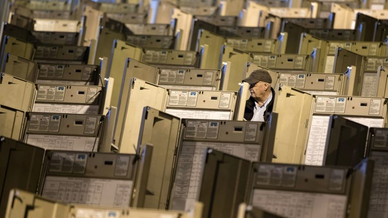 A technician is shown in October working to prepare voting machines to be used in the presidential election