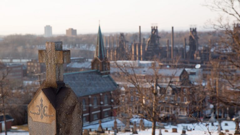 A knockoff of Walker Evans' 1935 photograph from St. Michael's Cemetery in south Bethlehem looking at the blast furnaces in the distance taken March 11, 2015. (Lindsay Lazarski/WHYY)