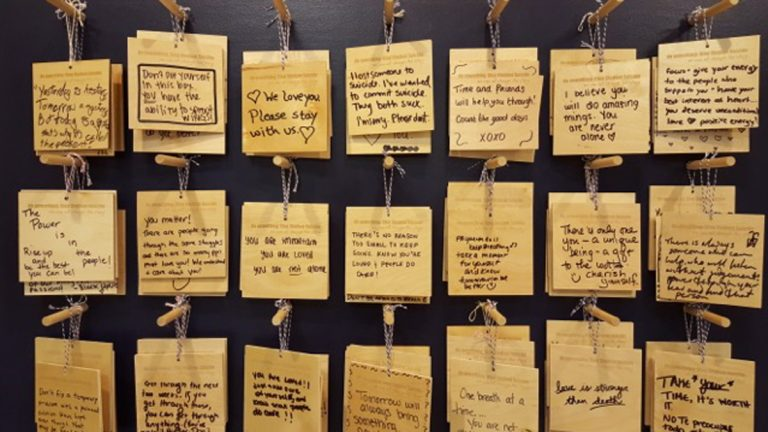 The wall of messages outside of University of Michigan's Counseling and Psychological Center. (Renee Gross/for WHYY)