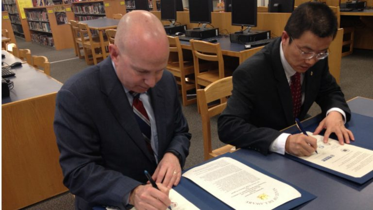 Governor Jack Markell (left) and Wanxiang Project Manager Daniel Li sign a memorandum of understanding to expand the company-sponsored study abroad program. (Avi Wolfman-Arent, NewsWorks/WHYY)