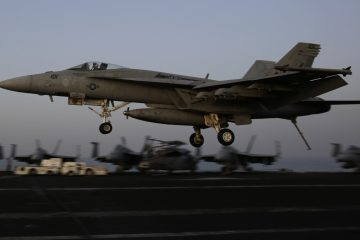 An F/A-18C Hornet coming from Iraq lands on the flight deck of the U.S. Navy aircraft carrier USS George H.W. Bush, Sunday, Aug. 10, 2014, in the Persian Gulf. Aircraft aboard the George H.W. Bush are flying missions over Iraq after U.S. President Barack Obama authorized airstrikes against Islamic militants and food drops for Iraqis trapped by the fighters. (AP Photo/Hasan Jamali)