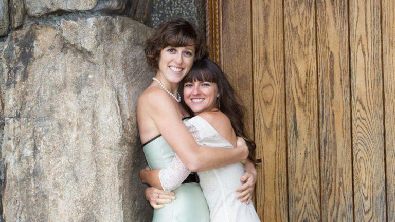 Megan Schneider (left) and Rachelle Schneider on their wedding day in 2013. (Photo by B. Proud)