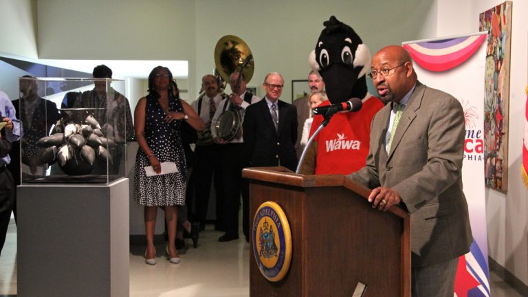 With litteral fanfare, Mayor Michael Nutter announces the return of the Wawa Welcome America July 4 celebration featuring fireworks, free sandwiches and The Roots. (Emma Lee/WHYY)