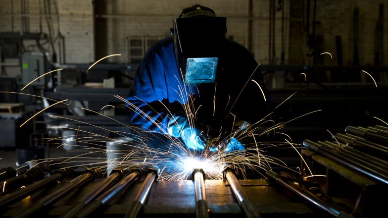 In this file photo, a welder fabricates anchor bolts for roads and bridges at the custom manufacturer in Pennsylvania.  (AP Photo/Matt Rourke)