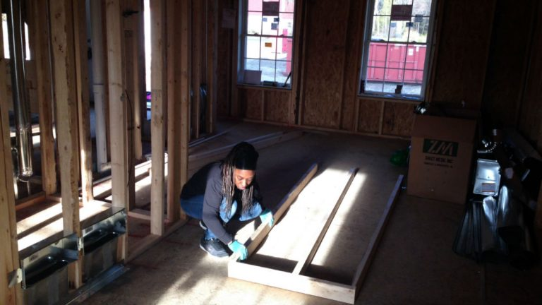 Amanda West works inside the home she's helping to build for her family in Georgetown. (Mark Eichmann/WHYY)
