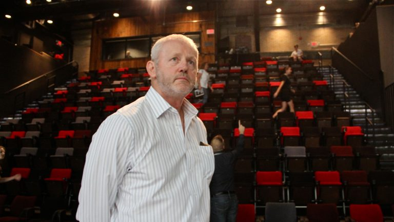 Actor David Morse paces the performance space at the Fringe Arts Building before his first and only performance of 'White Rabbit, Red Rabbit.' (Emma Lee/WHYY)